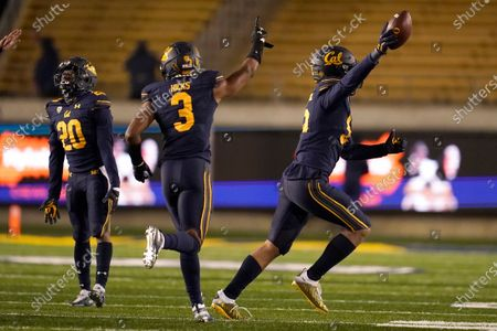 Stock Picture of California linebacker Muelu Iosefa, right, celebrates with Josh Drayden (20) and Elijah Hicks (3) after recovering a fumble by Oregon wide receiver Johnny Johnson III during the second half of an NCAA college football game in Berkeley, Calif