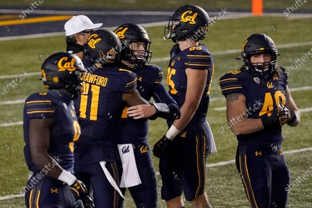 Stock Picture of California quarterback Chase Garbers, center, celebrates with wide receiver Kekoa Crawford (11) and other teammates during the second half of an NCAA college football game against Oregon in Berkeley, Calif