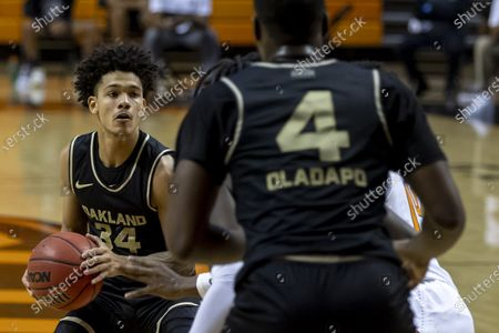 Oakland's Jalen Moore holds the ball in the first half of an NCAA college basketball game against Oklahoma State in Stillwater, Okla