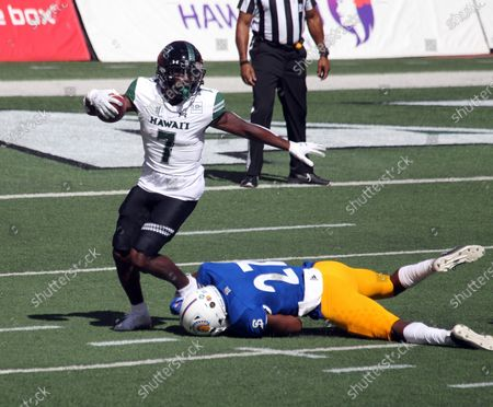 San Jose State Spartans safety Jay Lenard #27 makes an ankle tackle on Hawaii Rainbow Warriors running back Calvin Turner #7 during a game between the Hawaii Rainbow Warriors and the Nevada Wolfpack at Aloha Stadium in Honolulu, HI - Michael Sullivan/CSM