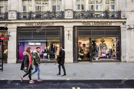 Shoppers walk past Karl Lagerfeld shop in Regent street.People have started flocking to central London as the capital has been placed in tier 2 on 2nd December after a month national lockdown.
