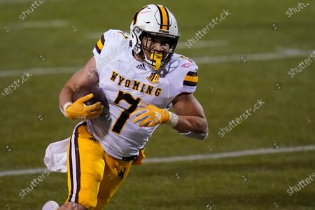 Wyoming running back Trey Smith (7) plays against New Mexico in an NCAA college football game, in Las Vegas
