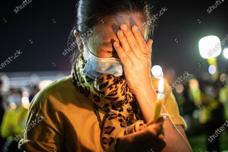 A Thai royalist supporters cry in front of the Grand Palace at Sanam Luang during a ceremony to celebrate the birthday of late Thai King Bhumibol Adulyadej (Rama 9). Thai King Maha Vajiralongkorn (Rama 10), took part during the ceremony along with other members of the Royal Family.