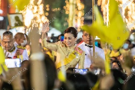Thailand Queen Suthida Bajrasudhabimalalakshana waves to royalist supporters in front of the Grand Palace at Sanam Luang during a ceremony to celebrate the birthday of late Thai King Bhumibol Adulyadej (Rama 9). Thai King Maha Vajiralongkorn (Rama 10), took part during the ceremony along with other members of the Royal Family.