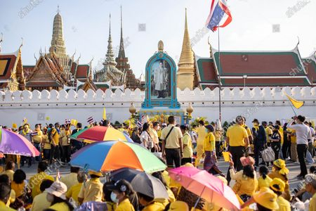 Thai royalist supporters gather in front of the Grand Palace at Sanam Luang next to a portrait of late Thai King Bhumibol Adulyadej during a ceremony to celebrate the birthday of late Thai King Bhumibol Adulyadej (Rama 9). Thai King Maha Vajiralongkorn (Rama 10), took part during the ceremony along with other members of the Royal Family.