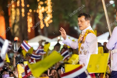 Thailand King Maha Vajiralongkorn (Rama X) waves to royalist supporters in front of the Grand Palace at Sanam Luang during a ceremony to celebrate the birthday of late Thai King Bhumibol Adulyadej (Rama 9). Thai King Maha Vajiralongkorn (Rama 10), took part during the ceremony along with other members of the Royal Family.
