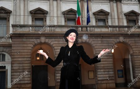 Stock Picture of United States' soprano Lisette Oropesa poses in front of La Scala opera theater in Milan, Italy, . Soprano Lisette Oropesa was to be the first American to single a title role in the gala season opener of La Scala since Maria Callas in the 1950s. Then Italy's virus cases surged, with an outbreak in both La Scala's chorus and orchestra, forcing Italy's premier opera house to cancel one of the top events on the European cultural calendar for the first time. Oropesa is one of 24 singers recording for a broadcast event marking the traditional Dec. 7 opening