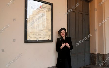 United States' soprano Lisette Oropesa poses in front of La Scala opera theater in Milan, Italy, . Soprano Lisette Oropesa was to be the first American to single a title role in the gala season opener of La Scala since Maria Callas in the 1950s. Then Italy's virus cases surged, with an outbreak in both La Scala's chorus and orchestra, forcing Italy's premier opera house to cancel one of the top events on the European cultural calendar for the first time. Oropesa is one of 24 singers recording for a broadcast event marking the traditional Dec. 7 opening