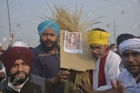 Demonstrators at the National Highway-9 (NH9) protest site with an effigy of actor Kangana Ranaut which they attempted to burn,on December 5, 2020 in Ghaziabad, India. In today's meeting, the farmers union went on a 'maun vrat' (vow of silence)  and sought a reply in 'yes' or 'no' on their key demand of repealing the three new farm laws. They also threatened to walk out if the government was not willing to scrap the laws. Thousands of farmers are protesting on various borders of the national capital since November 26, seeking repeal of three farm laws enacted in September.
