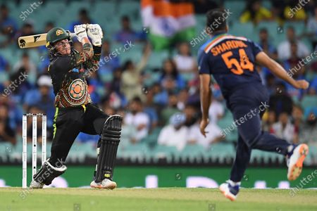 Moises Henriques (L) of Australia in action during the second T20 cricket match between Australia and India at the SCG in Sydney, Australia, 06 December 2020.