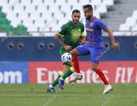 Joan Oumari, right, and Renato Augusto fight for the ball during a round of 16 AFC Champions League match in Al Rayyan, Qatar