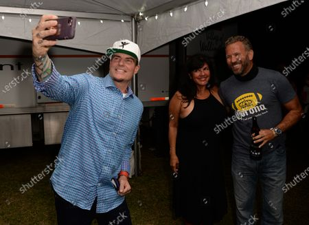Stock Image of Vanilla Ice poses with fans backstage during the Wellington Chamber of Commerce Winterfest concert