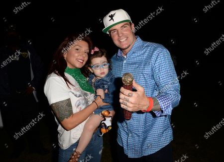 Stock Picture of Vanilla Ice poses with his daughter Priscilla and girlfriend Kirra backstage during the Wellington Chamber of Commerce Winterfest concert
