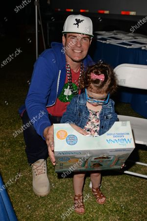Vanilla Ice poses with his daughter Priscilla backstage during the Wellington Chamber of Commerce Winterfest concert