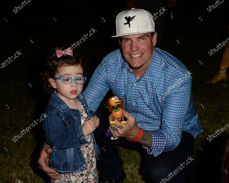 Stock Photo of Vanilla Ice poses with his daughter Priscilla backstage during the Wellington Chamber of Commerce Winterfest concert