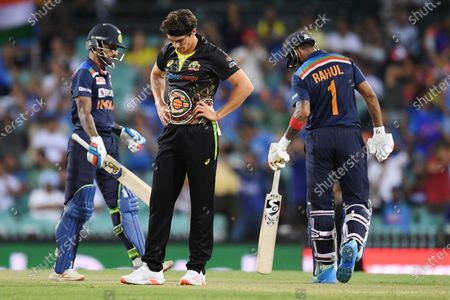 Sean Abbott of Australia reacts after being hit to the boundary during the second T20 cricket match between Australia and India at the SCG in Sydney, Australia, 06 December 2020.
