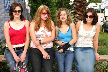 Brett Anderson, Maya Ford, Torry Castellano and Allison Robertson of The Donnas pose backstage