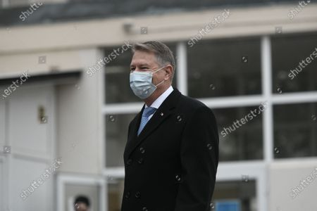 Romanian President Klaus Iohannis wearing a mask for protection against the COVID-19 infection waves as he arrives at a voting station in Bucharest, Romania, during legislative election, 06 December 2020.
