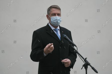 Stock Picture of Romanian President Klaus Iohannis wearing a mask for protection against the COVID-19 infection waves as he arrives at a voting station in Bucharest, Romania, during legislative election, 06 December 2020.