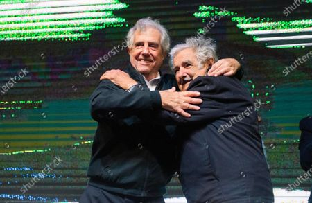 Uruguay's outgoing President Tabare Vazquez, left, embraces former President Jose Mujica, during a farewell party as the leftist government coalition ends its 15-year era in power, in Montevideo, Uruguay. The former president died at his home in Montevideo early