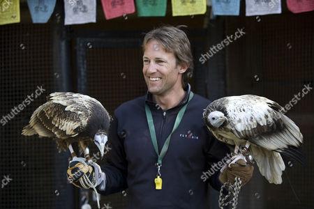 Scott Mason holding Egyptian vultures Kevin (right) and Bob (left)