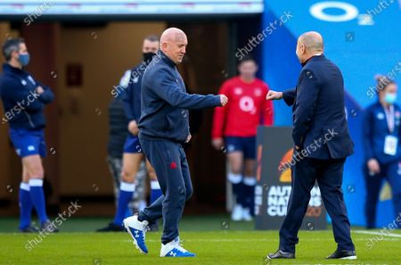 Stock Photo of England vs France. England Head Coach Eddie Jones greets Shaun Edwards Defence Coach of France