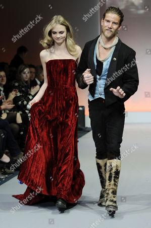 Model on the catwalk and designer Jeff Garner