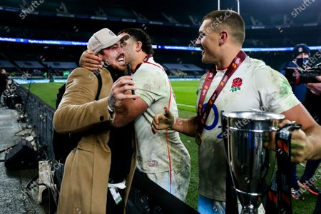 Jack Nowell congratulates Henry Slade and Ellis Genge after England win 22-19 with a penalty kick in sudden death extra time, to become Autumn Nations Cup Champions