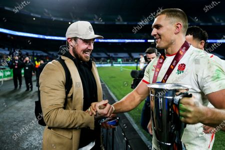 Stock Picture of Jack Nowell congratulates Henry Slade after England win 22-19 with a penalty kick in sudden death extra time, to become Autumn Nations Cup Champions