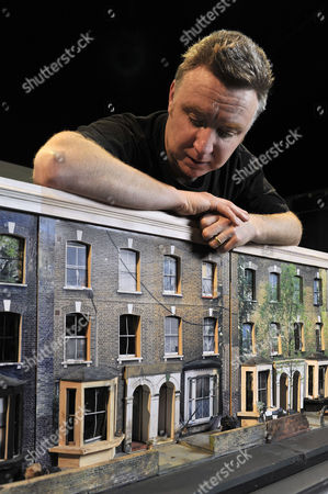 Tom Hunter, pictured with his photosculpture 'The Ghetto' during installation at the Museum of London