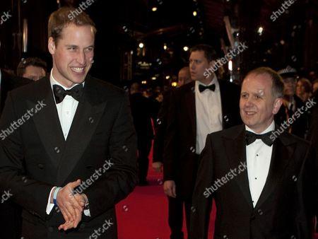 Prince William walks with BAFTA chairman David Parfitt (R)
