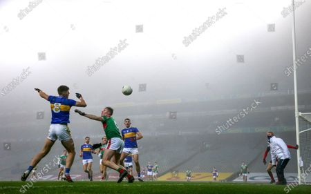 Mayo vs Tipperary. Mayo's Stephen Coen and Steven O'Brien of Tipperary