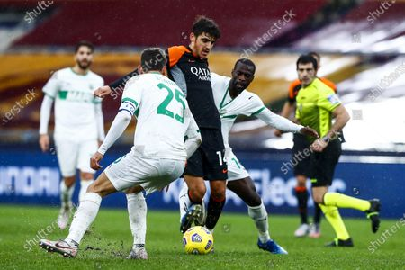 Roma's Gonzalo Villar (L) and Sassuolo's Pedro Obiang (R) in action during the Italian Serie A soccer match AS Roma vs US Sassuolo at Olimpico stadium in Rome, Italy, 06 December 2020.