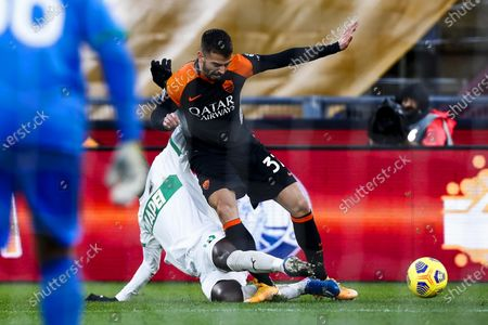 Sassuolo's Pedro Obiang (L) and Roma's Leonardo Spinazzola (R) in action during the Italian Serie A soccer match AS Roma vs US Sassuolo at Olimpico stadium in Rome, Italy, 06 December 2020.