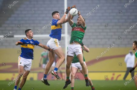 Mayo vs Tipperary. Mayo's Tom Parsons with Steven O'Brien of Tipperary