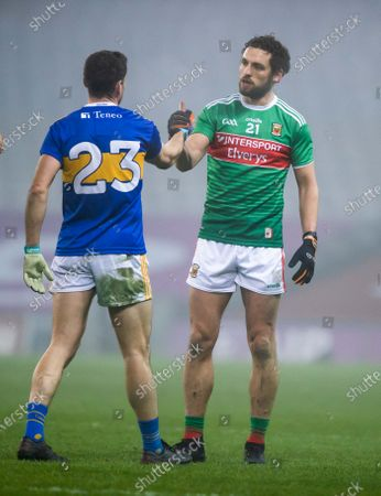 Mayo vs Tipperary. Mayo's Tom Parsons and Philip Austin of Tipperary after the game