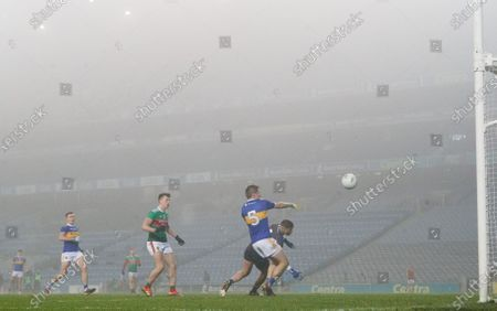 Stock Photo of Mayo vs Tipperary. Mayo's Cillian O'Connor scores his sides fifth goal despite Bill Maher and Evan Comerford of Tipperary
