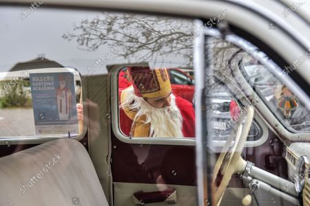Santa Claus with a sack full of presents arrives at the University Children's Hospital on the Saint Nicholas Day in Lublin, eastern Poland, 06 December 2020. Traditionaly, children in Poland receive presents on the Saint Nicholas Day and Christmas Eve.