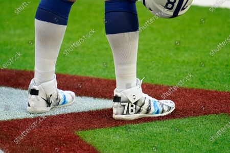 Indianapolis Colts offensive lineman Ryan Kelly (75) wears the My Cause My Cleats during pregame warmups before an NFL football game against the Houston Texans, in Houston