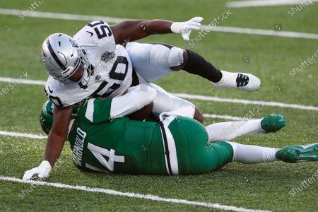 Las Vegas Raiders' Nicholas Morrow, top, sacks New York Jets quarterback Sam Darnold during the second half an NFL football game, in East Rutherford, N.J