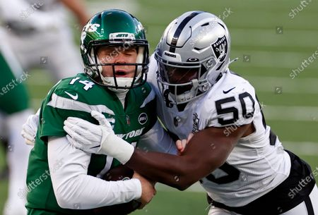 Las Vegas Raiders outside linebacker Nicholas Morrow (50) sacks New York Jets quarterback Sam Darnold (14) during an NFL football game, in East Rutherford, N.J