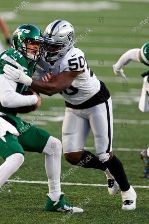 Stock Photo of Las Vegas Raiders outside linebacker Nicholas Morrow (50) sacks New York Jets quarterback Sam Darnold (14) during an NFL football game, in East Rutherford, N.J