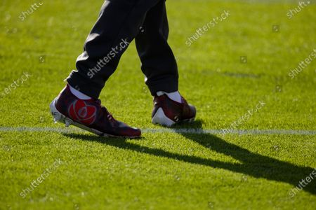 Detail view of custom cleats worn by Cleveland Browns linebacker Tae Davis (55) before an NFL football game against the Tennessee Titans, in Nashville, Tenn