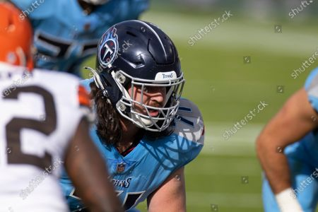 Stock Picture of Tennessee Titans offensive tackle Dennis Kelly (71) lines up in position against the Cleveland Browns during the second quarter of an NFL football game, in Nashville, Tenn