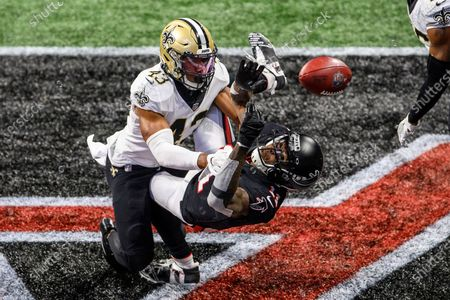 Atlanta Falcons wide receiver Julio Jones (11) can't make the catch as New Orleans Saints free safety Marcus Williams (43) defends during the second half of an NFL football game, in Atlanta. The New Orleans Saints won 21-16