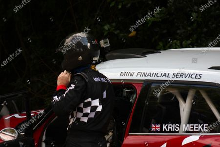 Goodwood Estate, West Sussex. 30th June - 3rd July 2011 Kris Meeke prepares to climb in to his Mini WRC car for a run up the hill. Portrait. Helmets. World Copyright: Lord Hutton/LAT Photographic