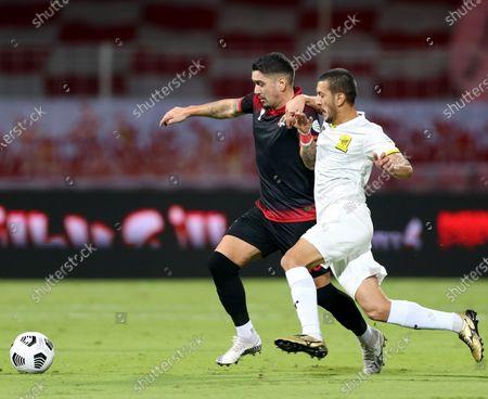 Al-Wehda's player Dimitri Petratos (L) in action against Al-Ittihad's Abdulelah Al Malki (R) during the Saudi Professional League soccer match between Al-Wehda and Al-Ittihad at King Abdulaziz Stadium, in Mecca, Saudi Arabia, 06 December 2020.
