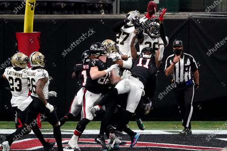Atlanta Falcons wide receiver Julio Jones (11) misses a catch in the end zone on the last play of the game against the New Orleans Saints during the second half of an NFL football game, in Atlanta. The New Orleans Saints won 21-16