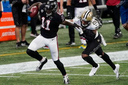 Atlanta Falcons wide receiver Julio Jones (11) runs against New Orleans Saints cornerback P.J. Williams (26) during the first half of an NFL football game, in Atlanta
