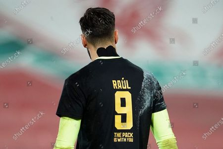 Wolverhampton Wanderers' goalkeeper Rui Patricio wears a shirt with the number nine of teammate Raul Jimenez during warmup before the English Premier League soccer match between Liverpool and Wolverhampton Wanderers at Anfield Stadium, Liverpool, England, . Jimenez got injured in a recent match
